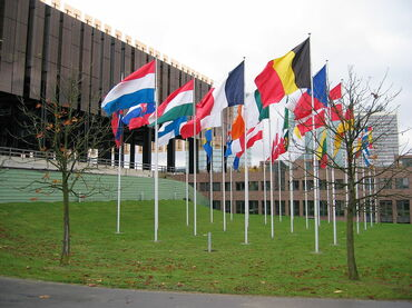 European_Court_of_Justice_(ECJ)_in_Luxembourg_with_flags.jpg